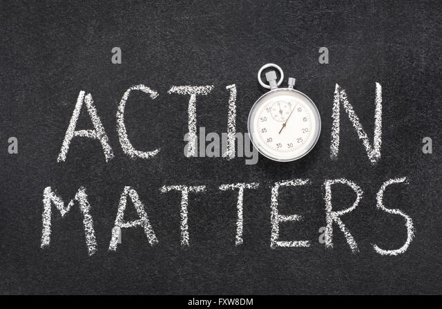 action matters phrase handwritten on chalkboard with vintage precise stopwatch used instead of O - Stock Image