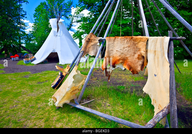 Animal skins drying in the sun at the Aboriginal Encampment, Lower Fort Garry - a National Historic Site, Selkirk, - Stock-Bilder