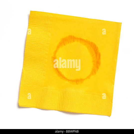 Yellow paper napkin with water ring - Stock Image