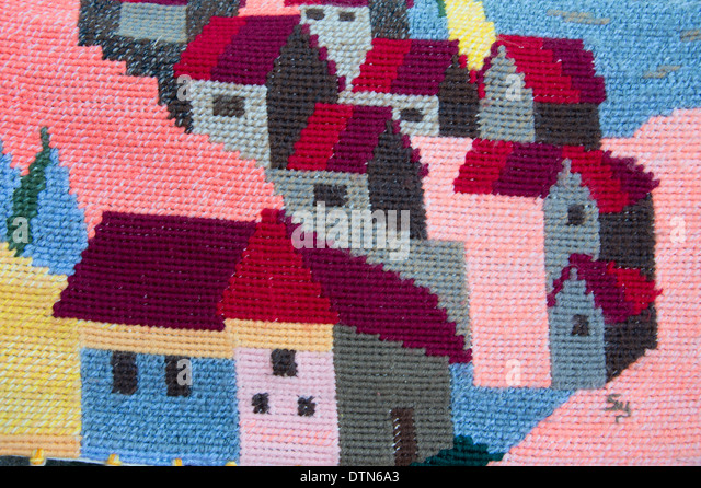 Uruguay, Montevideo. Typical wool souvenir textile with houses. - Stock Image