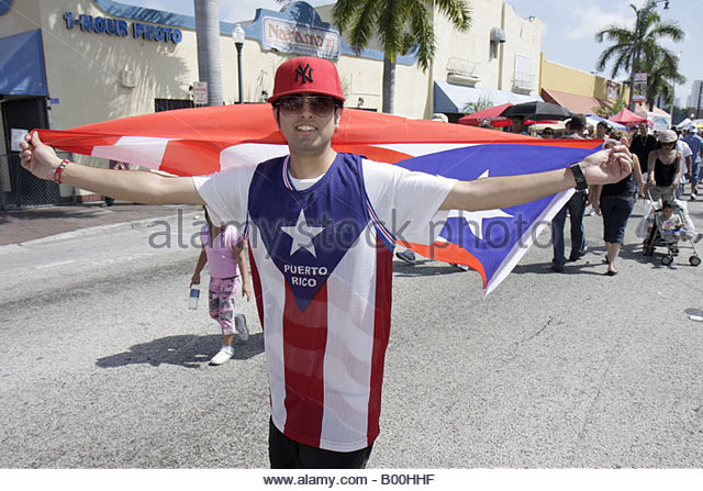 celebration man Puerto Rico Puerto Rican wrapped in flag national pride patriotism - Stock Image