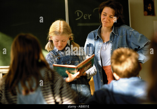 Kids and teacher in class - Stock Image