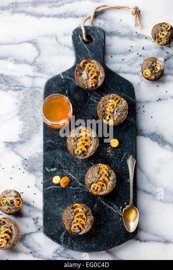 Kumquat and black sesame cakes - Stock Image