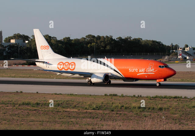 TNT Airways Boeing 737-400F cargo plane taxiing for departure from Malta - Stock Image