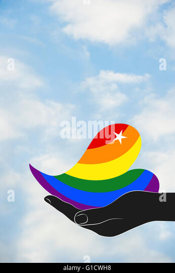 Hand holding rainbow heart. - Stock Image