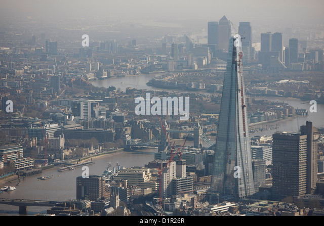 Aerial photograph showing the London skyline with the Shard and Canary Wharf  in the background - Stock Image
