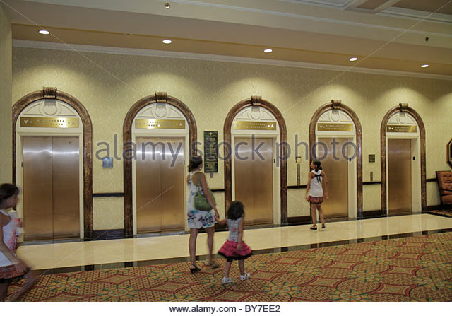 Baltimore Maryland Baltimore Street Radisson Plaza Lord Baltimore Hotel 1928 historic building lobby elevator woman - Stock Image