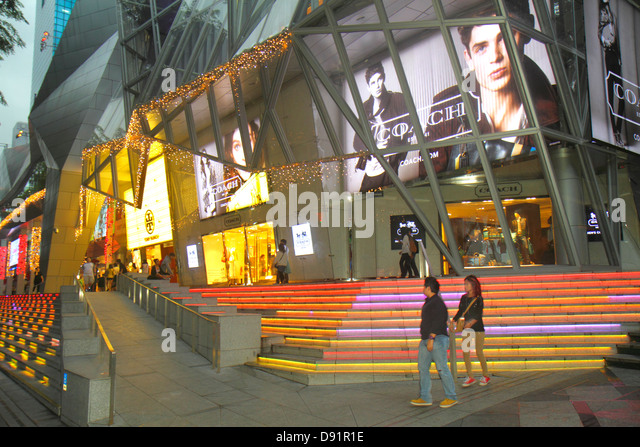 Singapore Orchard Road Ion Orchard mall complex upscale shopping outside entrance front steps Coach luxury leather - Stock Image