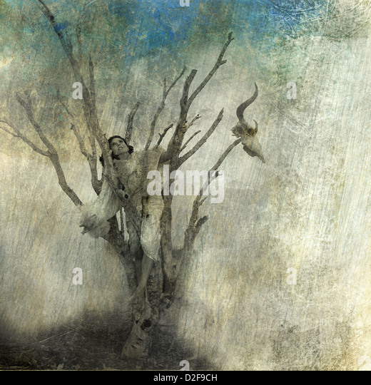 Woman in dead tree. Photo based mixed medium art.  - Stock Image