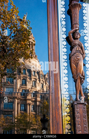 Architecture along Barcelona's Paseo de Gracia reflecting in window - Stock Image