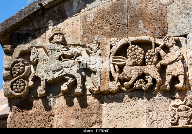 archer shooting bear, vintner and rabbit, The Cathedral Church of the Holy Cross (915-921), Akhdamar Islamd, Van - Stock Image