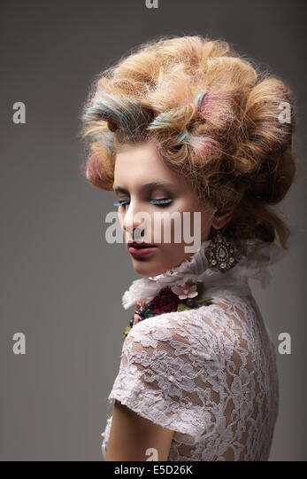Individuality. Haute Couture. Swanky Woman with Colored Hair - Stock Image