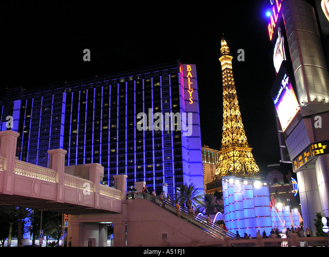 Las Vegas skyline stip at night bright neon lights landmark buildings architecture dark background - Stock Image