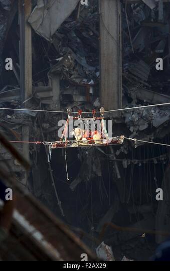 A rescue dog is transported out of the debris of the World Trade Center, Sept. 15, 2001. New York City, after September - Stock-Bilder