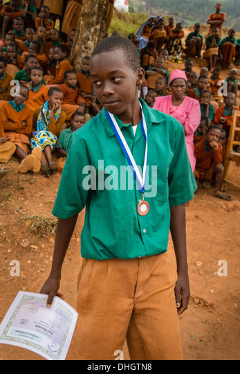Schoolboy with medal and certificate of achievement in a Kenyan Primary school in the Sagalla Hills near Voi Africa - Stock Image