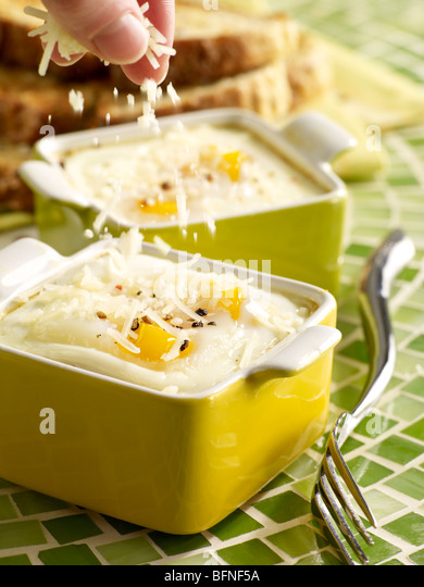 Baked Eggs with Parmesan sprinkling - Stock Image