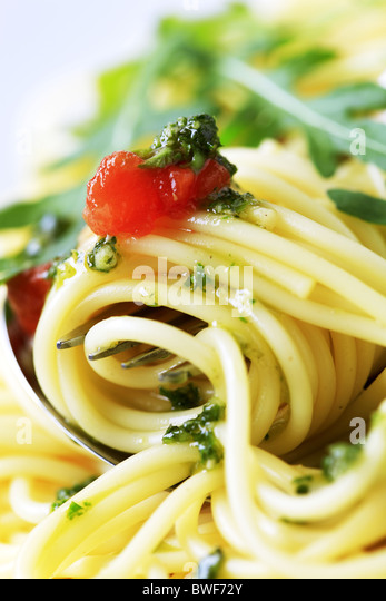 Macro shot of spaghetti twirled around a fork - Stock Image