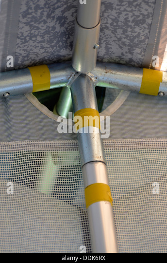 marked awning poles - Stock Image