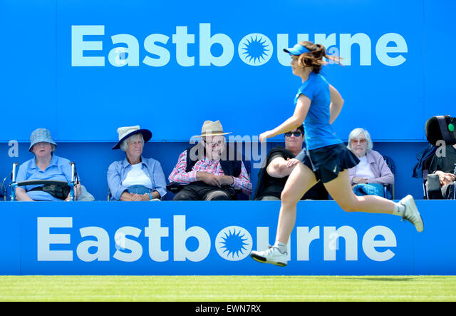 Elderly spectators and a running ball girl on centre court at the Aegon International tournament at Eastbourne, - Stock-Bilder