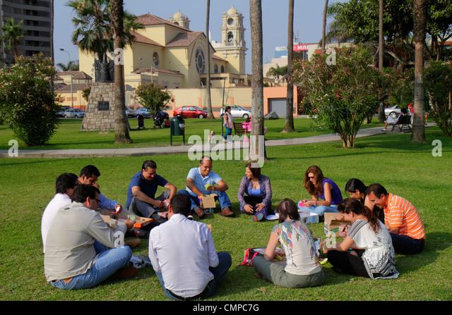 Lima Peru Miraflores Malecon de la Reserva Parque Domodossola urban park landscaping trees green space lawn Hispanic - Stock Image