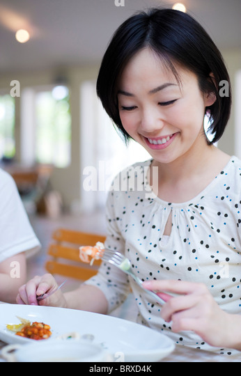 Young Woman Eating Lunch - Stock Image