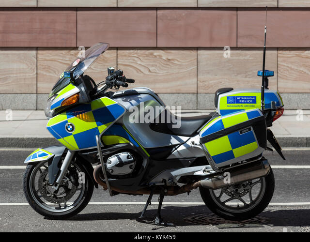 Parked Metropolitan Police motorcycle in the City of London, England, United Kingdom - Stock Image