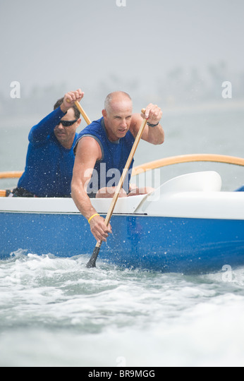 Outrigger canoeing team of two - Stock Image