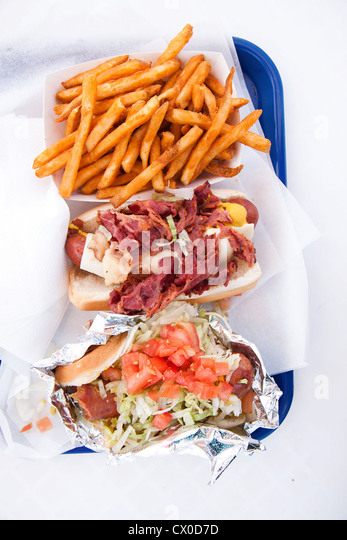 Sausage, Bacon and Salad Open Sandwiches Served with Fries - Stock Image