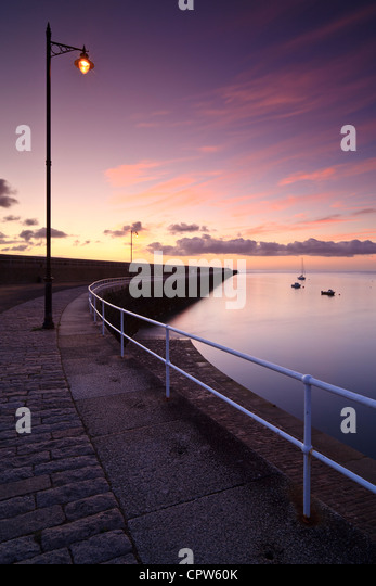 St Catherine's Breakwater, Jersey, Channel Islands, at sunrise - Stock Image