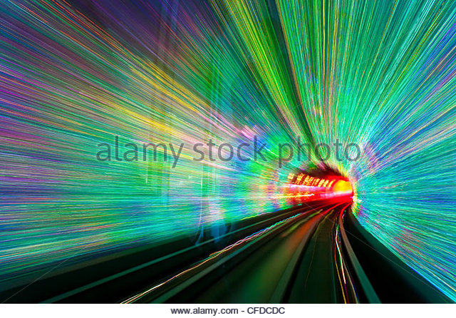 Blurred motion light trails in a train tunnel under the Huangpu River linking the Bund to Pudong, Shanghai, China, - Stock Image