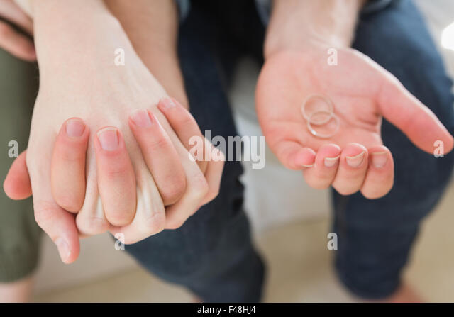 Homosexual couple holding wedding ring - Stock-Bilder