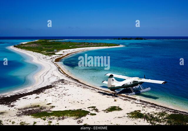 dehaviland dhc-3 otter seaplane on the beach and bush key at the dry tortugas florida keys usa - Stock Image