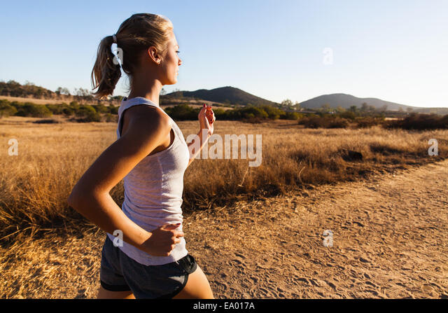 Young woman jogging, Poway, CA, USA - Stock Image