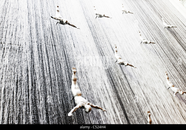 The Waterfall, life-size figures of divers in Dubai Mall, Dubai, United Arab Emirates, Middle East - Stock Image