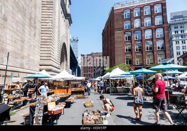 Brooklyn New York City NYC NY DUMBO Manhattan Bridge Anchorage Place pedestrian plaza Dumbo Flea Market outdoor - Stock Image