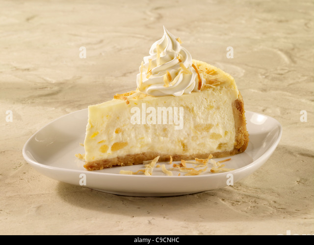 Pineapple coconut cheesecake topped with whipped cream - Stock Image