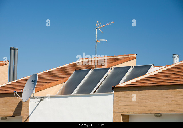 Solar water heaters on a house roof in Sanlucar La Mayor in Andalucia, Spain. - Stock Image