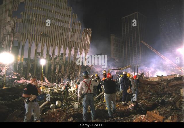 On the south west area of Ground Zero a bucket line removes debris at night, Sept 17, 2001. At left a section of - Stock-Bilder