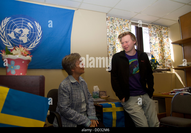 International guidance director talking to foreign student at Bethany College in Lindsborg, Kansas. - Stock Image