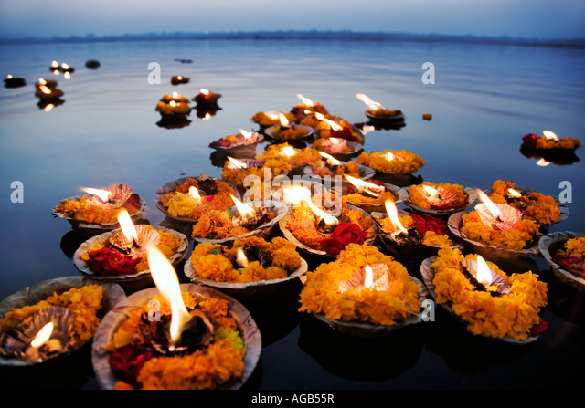 Deepak in the Ganges River The deepak or oil lamps are used as an offering to the Ganges River Varanasi India - Stock Image