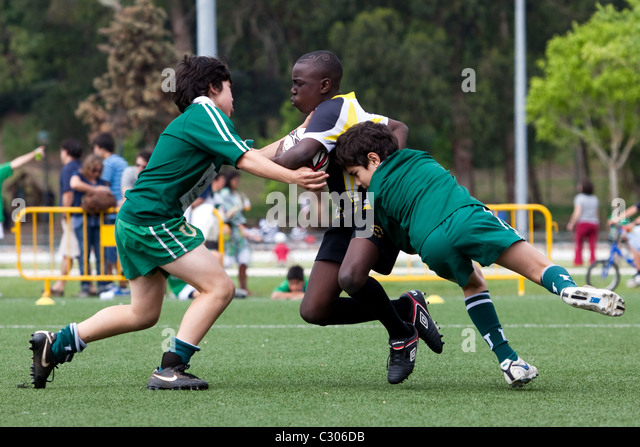 Young boys playng rugby at the Portugal Rugby Youth Festival 2011, Lisbon. - Stock Image