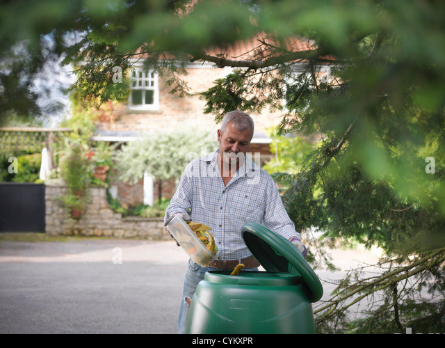 Man composting food scraps - Stock Image