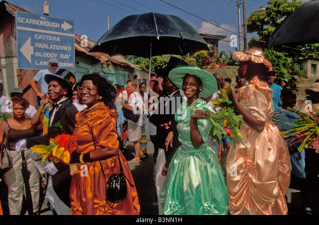 Tobago Heritage Festival Old Time Wedding women wear 18th and 19th century bustle dresses wide brimmed hats white - Stock Image