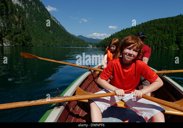 Children in a rowing boat on lake Königssee, Berchtesgadener Land district, Upper Bavaria, Bavaria, Germany - Stock Image