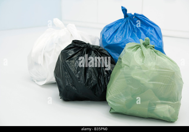 Assortment of garbage bags, all full - Stock Image