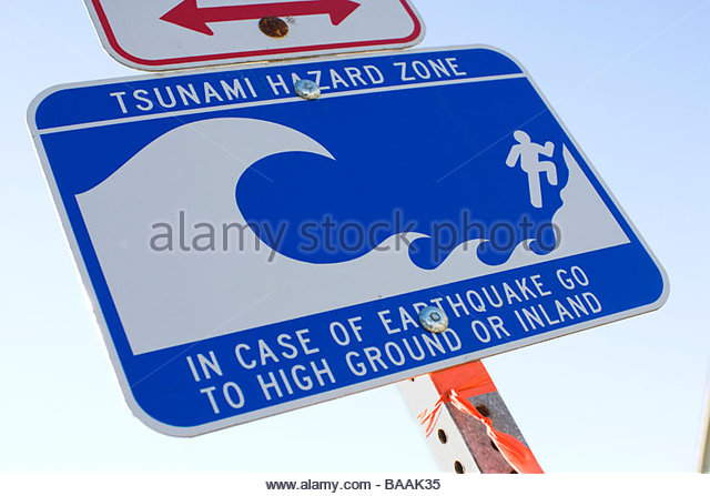 A sign warning that the immediate area is a tsunami hazard zone in Long Beach, California. - Stock Image