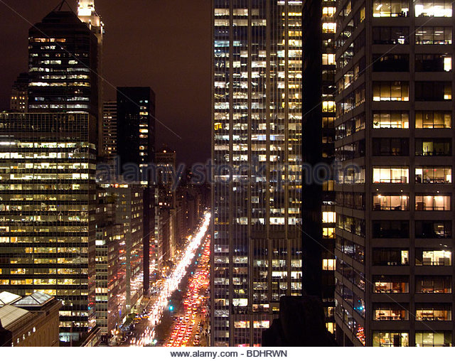 Urban cityscape with cars and highrises - Stock Image