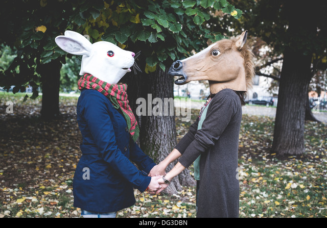 horse and rabbit mask women in the park autumn - Stock Image