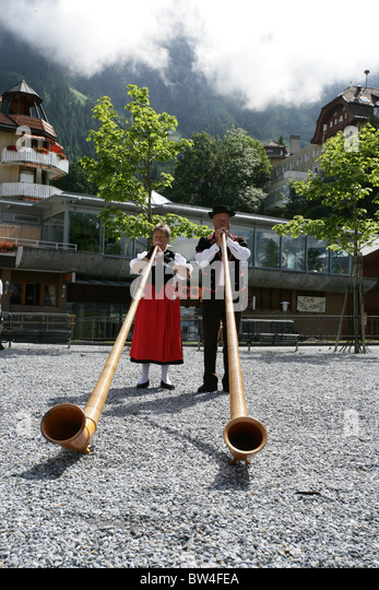 Swiss horn players perform in the twon centre of Wengen, Switzerland - Stock Image