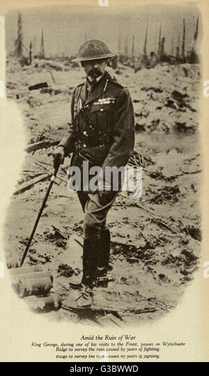 George V, King of Britain (1865 - 1936), pictured in Field-Marchal's service uniform and steel helmet on a visit - Stock Image